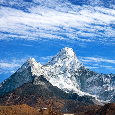 View of Ama Dablam on the way to Everest Base Camp with beautiful cloudy sky, Sagarmatha national park, Khumbu valley, Nepal Stock Photo