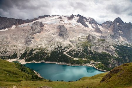 tarn: view of northern side or nort face of mount Mmarmolada with lago di Fedaia - top of dolomites, South Tirol, Italian Dolomites Stock Photo