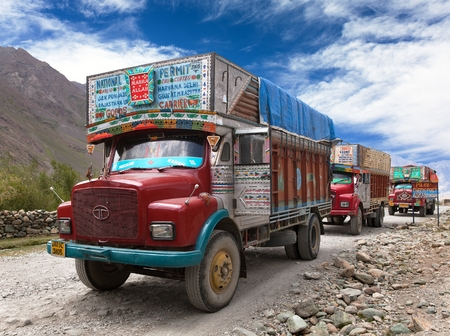 INDIA, LADAKH, CIRCA SEPTEMBER 2013 - Colorful trucks brand TATA in Indian Himalayas on himalayan high altitude road - Ladakh - Jammu and Kashmir