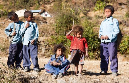 indigene: DOGADI VILLAGE, WESTERN NEPAL - 8TH OF DECEMBER 2013 - group of nepalese children in western Nepal