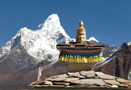 buddhist temple roof: Buddhist Temple - detail of roof with mount Ama Dablam - Nepal Stock Photo