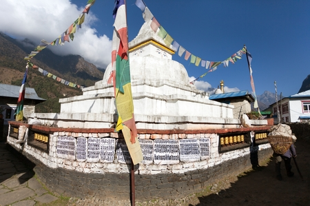 bazar: Stupa with prayer flags and wheels on the way from Lukla to Namche bazar in chaurikharka near chheplung village - nepal Stock Photo