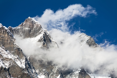 icefall: top of Lhotse and Nuptse with clouds on the top - way to mount Everest base camp, Khumbu valley, Sagarmatha national park, Nepalese Himalayas