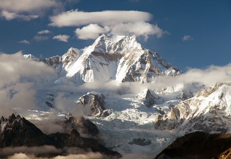 Evening view from Gokyo Ri to mount Gyachung Kang 7952m within clouds near Cho Oyu, way to Cho Oyu base camp