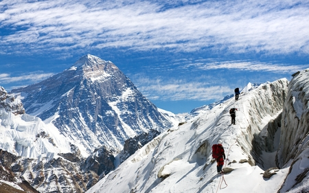 view of Everest and Lhotse from Gokyo valley with group of climbers on glacier, way to Everest base camp, Sagarmatha national park, Khumbu valley, Nepalese Himalayas