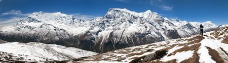 2 way: Panoramic view of Annapurna 2 II, 3 III, 4 IV, Ganggapurna and Khangsar Kang, from Ice Lake and tourist, way to Thorung La pass, Annapurna circuit trek, Nepal Stock Photo