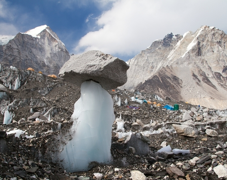 View from Mount Everest base camp with abstract ice and stone mushroom and tents, sagarmatha national park, trek to Everest base camp - Nepal