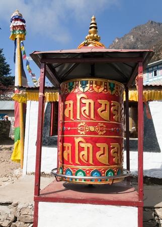 Prayer wheel in Tamo - monastery in Khumbu valley on three passes trek, Mount Everest area, Sagarmatha national park, Nepal