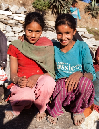 indigene: KOLTI VILLAGE, WESTERN NEPAL, 3rd DECEMBER 2013 - two nepalese children, young girls, in western Nepal near Kolti village Editorial