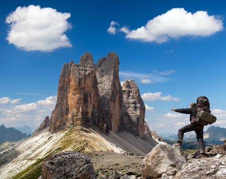 italien: Drei Zinnen or Tre Cime di Lavaredo with hiker, Sextener Dolomiten or Dolomiti di Sesto, South Tirol, Dolomiten mountains view, Italien Alps