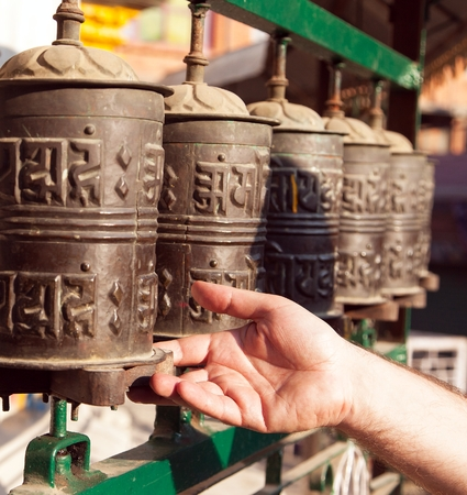 sanskrit: View of Prayer wheels and a hand