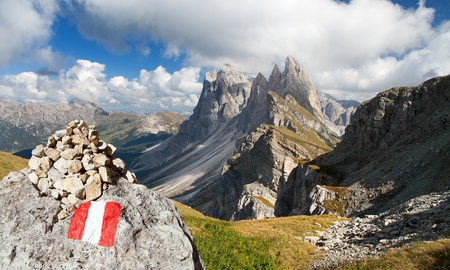 View of Geislergruppe or Gruppo delle Odle with tourist sign, Italian Dolomites mountains