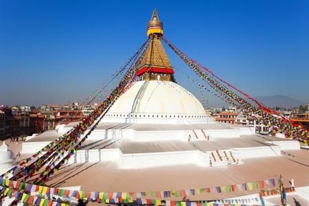 monastic: Evening view of Bodhnath stupa with prayer flags - Kathmandu - Nepal
