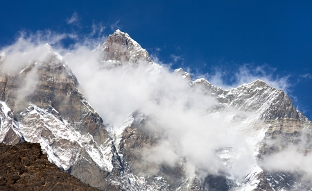 icefall: top of mount Lhotse and Lhotse Shar with clouds on the top - way to mount Everest base camp, Khumbu valley, Sagarmatha national park, Nepalese Himalayas