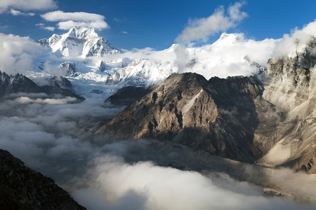 Evening view from Gokyo Ri to mount Gyachung Kang 7952m within clouds, way to Cho Oyu base camp, three passes trekking route, Gokyo valley, Sagarmatha national park, Khumbu valley, Nepal