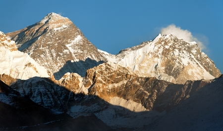 Evening panoramic view of mount Everest and Lhotse with blue sky from Gokyo valley - Everest area, Khumbu valley, Nepal Stock Photo