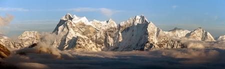 inversion: Evening panoramic view of mounts Kangtega and Thamserku fromm Gokyo Ri, Everest area, Khumbu valley, Nepal