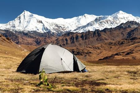 View of tent, Putha Churen Himal and Dhaulagiri Himal - Dhaulagiri VI - Guerrilla trek - western Nepalese Himalayas Stock Photo