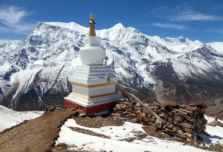Panoramic view of Annapurna 2 II, 3 III, 4 IV, Ganggapurna and Khangsar Kang, Annapurna range with stupa, way to Thorung La pass, round Annapurna circuit trekking trail, Nepal