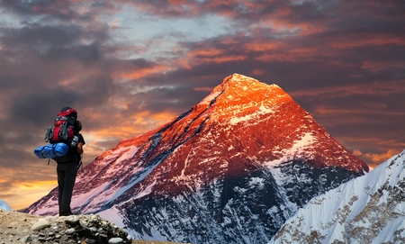 Evening colored view of Mount Everest from Gokyo valley with tourist on the way to Everest base camp, Sagarmatha national park, Khumbu valley, Nepal
