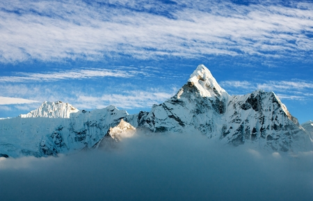 cirrus: View of Ama Dablam on the way to Everest Base Camp with beautiful cloudy sky, Sagarmatha national park, Khumbu valley, Nepal Stock Photo