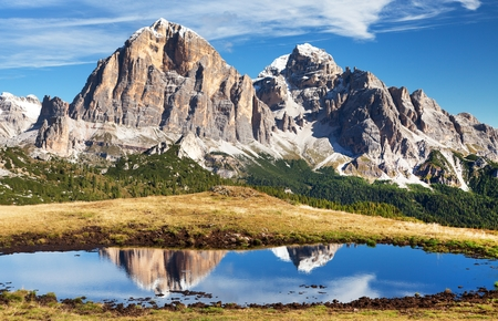 View from passo Giau, Tofana or Le Tofane Gruppe, mountain mirroring in lake, Dolomites, Italy