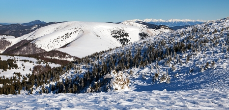 Panoramic wintry view from Velka Fatra mountains ridge to High Tatras mountains Stock Photo