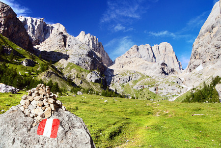 high sierra: view of southern side of Marmolada with tourist sign, top of Alps Dolomites mountains, Dolomiti, Italy