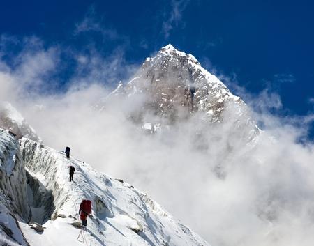 group of climbers on mountains montage to mount Lhotse, Everest area, Khumbu valley, Nepal Stock Photo