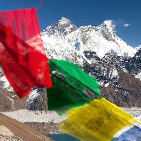 view of Mount Everest and Lhotse with buddhist prayer flags from Gokyo Ri - way to Everest base camp, Sagarmatha national park, Khumbu valley, Solukhumbu, Nepal Himalayas Stock Photo