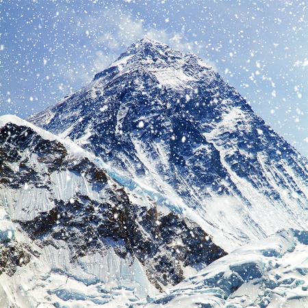 View of top of Mount Everest with clouds and snowfall from Kala Patthar way to mount Everest base camp, khumbu valley, nepalese himalayas - Nepal Stock Photo