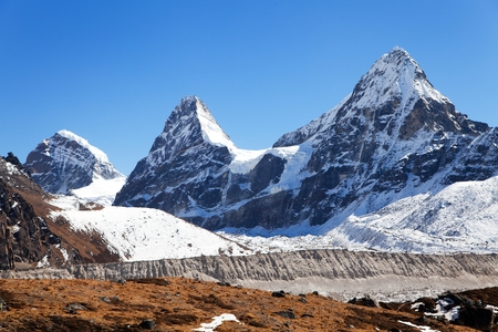 View of mount Cholo, Kangchung peak and Nirekha peak, way to Cho Oyu base camp, Gokyo valley, Sagarmatha national park, Khumbu valley, Nepalese Himalayas