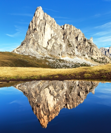 View from passo Giau, mount Ra Gusela from Nuvolau gruppe, mountain mirroring in lake, Dolomites, Italy
