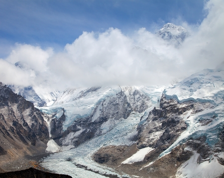 View of top of Mount Everest and Khumbu glacier with clouds from Kala Patthar way to mount Everest base camp, khumbu valley - Nepal Stock Photo