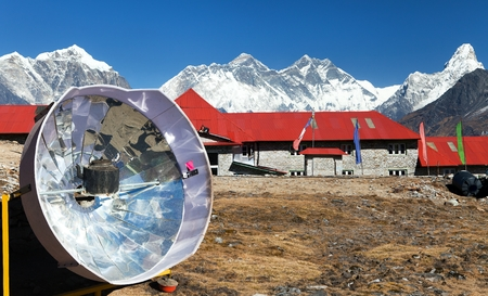 Panoramic view of Mount Everest, Lhotse and Ama Dablam from Kongde with tourist lodge and solar cooker, Sagarmatha national park, Nepal