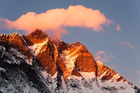 evening sunset view of Lhotse and clouds on the top, warm tone - way to mount Everest base camp, khumbu valley, Solukhumbu, Nepal Himalayas mountains Stock Photo