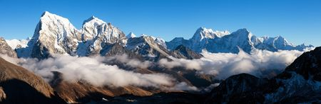 Evening panoramic view from Gokyo Ri to mounts Kangtega, Thamserku Arakam Tse, Cholatse and Tabuche Peak - trek to Everest base camp - Nepal Himalayas mountains Stock Photo