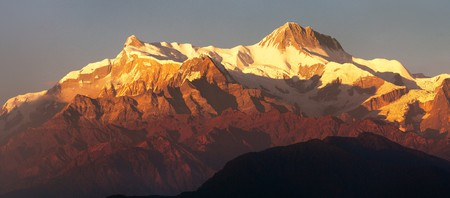 Evening red colored sunset panoramic view of Annapurna Himal range, Annapurna 2 II and 4 IV, Nepal Himalayas mountains