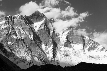 Mount Lhotse with clouds on the top - way to mount Everest base camp, Khumbu valley, Sagarmatha national park, Nepalese Himalayas mountains, black and white view