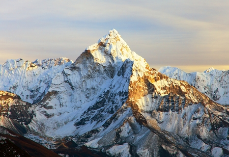 Evening panoramic sunset view of Ama Dablam with beautiful clouds on the way to Everest Base Camp, Khumbu valley, Solukhumbu, Nepal Himalayas mountains