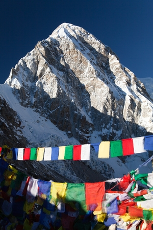 view of Mount Pumo Ri with buddhist prayer flags from Kala Patthar, way to Everest base camp, Nepal Himalayas mountains