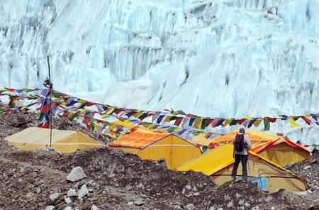 View from Mount Everest base camp, tents and prayer flags, sagarmatha national park, Khumbu valley, solukhumbu, Nepal Himalayas mountains Stock Photo