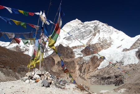 Mount Makalu with lake and buddhist prayer flags, Maklu Barun national park, Nepal Himalayas mountains Stock Photo