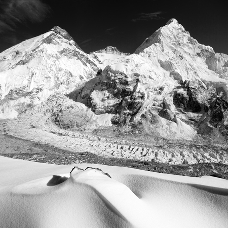 View of Mount Everest, Lhotse and Nuptse from Pumo Ri base camp, way to Mount Everest base camp, Sagarmatha national park, Nepal Himalayas mountains, black and white Standard-Bild - 109641962