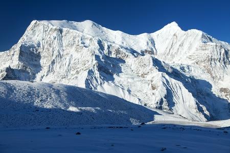Panoramic view of Annapurna 3 III blue colored, Annapurna range, Annapurna circuit trekking trail, Nepal Himalayas mountains 写真素材