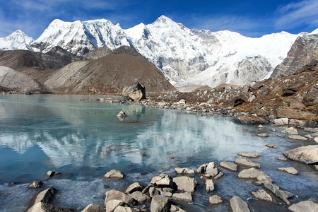 view of mount Cho Oyu mirroring in lake - Cho Oyu base camp - Everest trek - Nepal Himalayas mountains