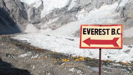 View from Mount Everest base camp, tents and prayer flags and signpost way to mount everest b.c. sagarmatha national park, trek to Everest base camp - Nepal Himalayas mountains