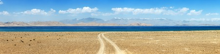 Karakul lake and Pamir range in Tajikistan. Landscape around Pamir highway M41 international road, roof of the world
