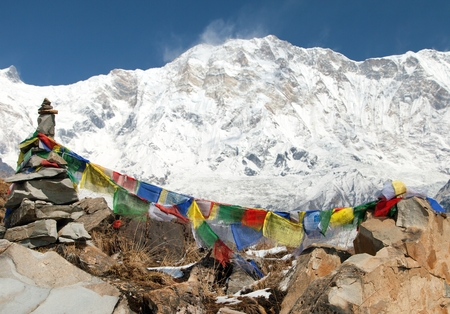 Buddhist prayer flags and Mount Annapurna from Annapurna base camp, Nepal Himalayas mountains