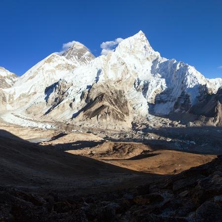 Evening sunset panoramic view of mount Everest and mount Nuptse with beautiful blue sky from Kala Patthar, Khumbu valley, Sagarmatha national park, Nepal Himalayas mountains